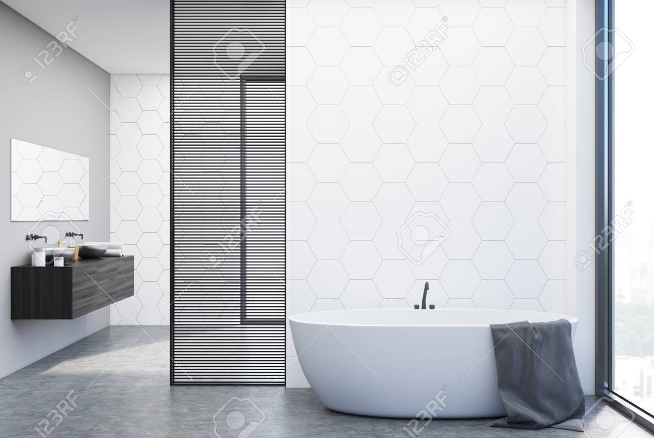 white hexagon tile bathroom interior with a double sink standing