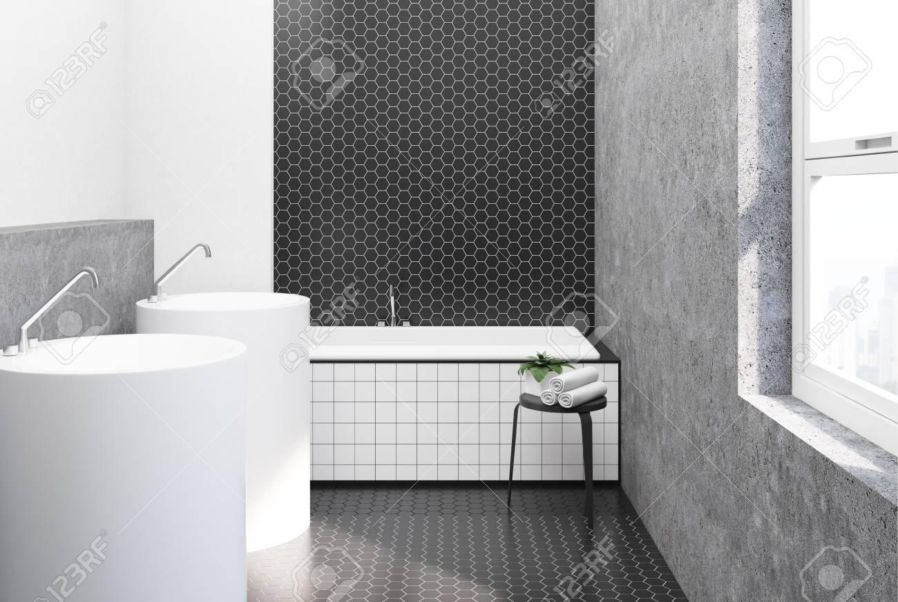 bathroom interior with black hexagon tile and concrete walls