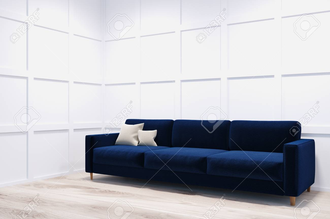 blue fl sofa what colour walls with charcoal long and comfortable dark standing in a room corner white