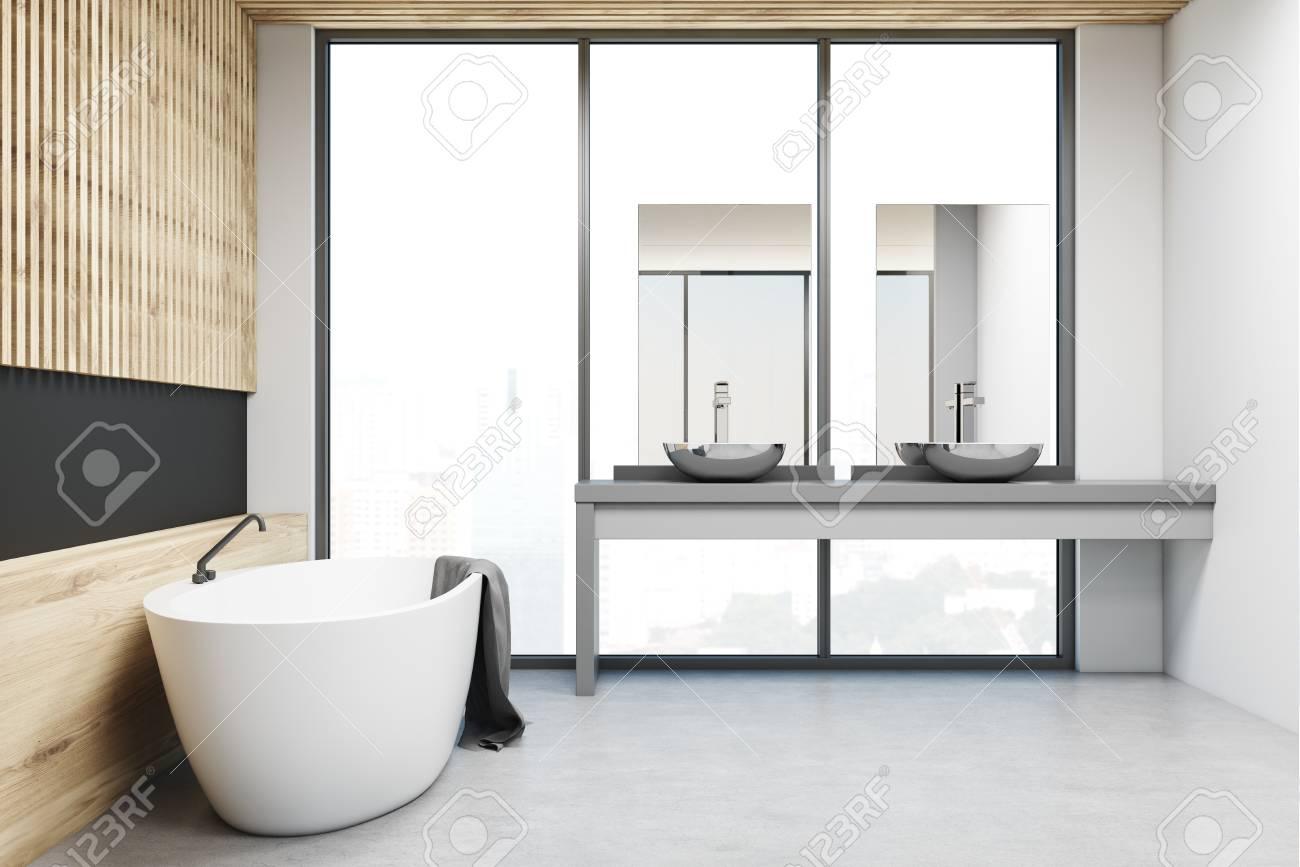 interieur de salle de bain moderne en bois et mur noir avec un sol en beton une fenetre panoramique et une baignoire blanche un evier double
