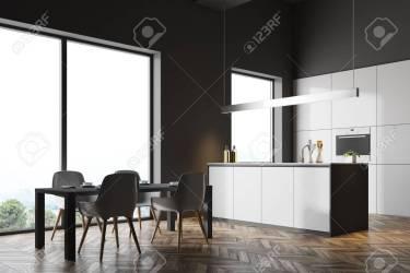 Interior De Cocina Loft De Pared Gris Oscuro Con Piso De Madera Y Encimeras Blancas Debajo De Una Lámpara Original Una Mesa Con Sillas Blancas Una Vista Lateral Representación 3D Simulacro Fotos