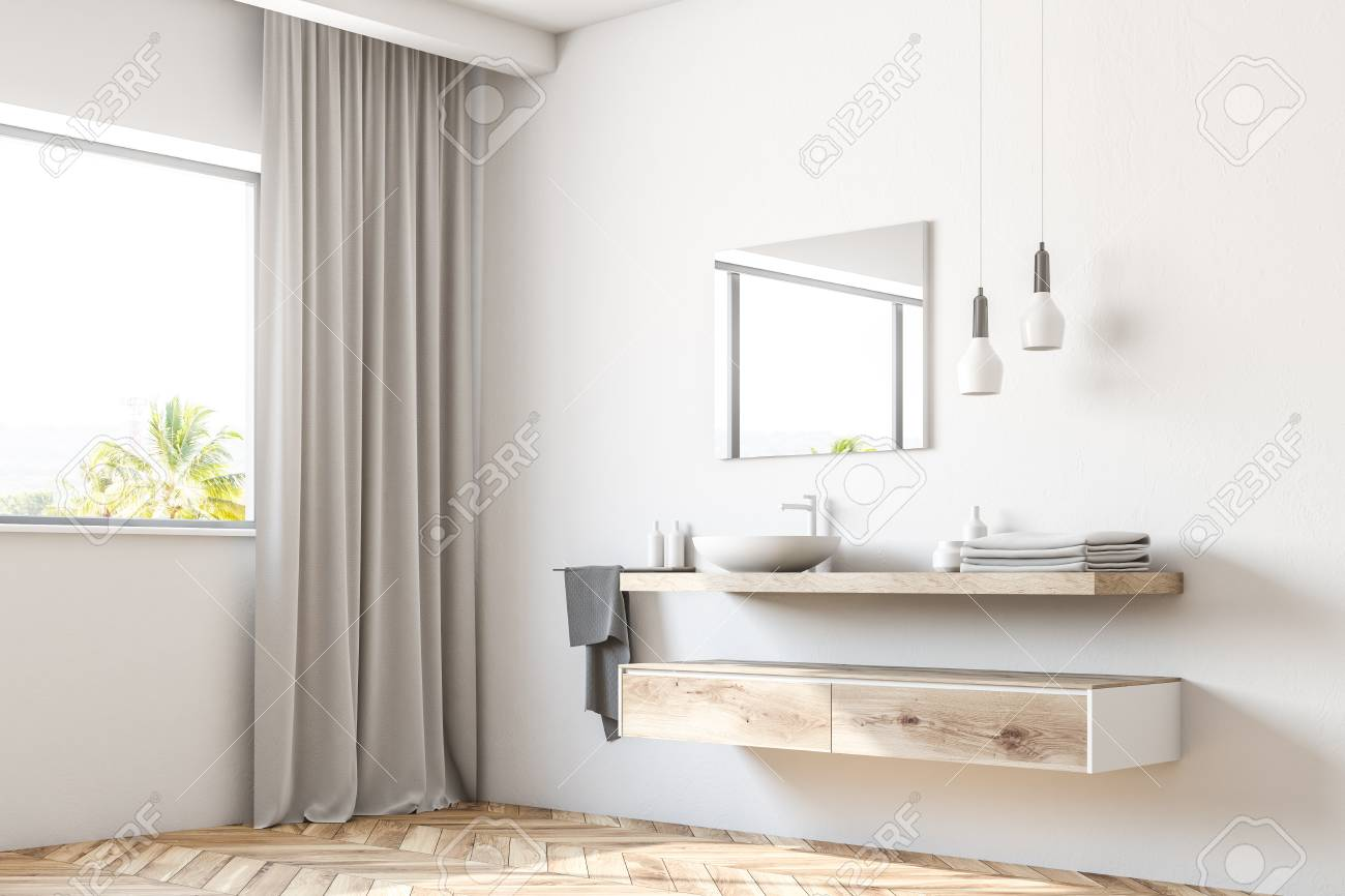 white bathroom sink standing on a wooden shelf a square mirror