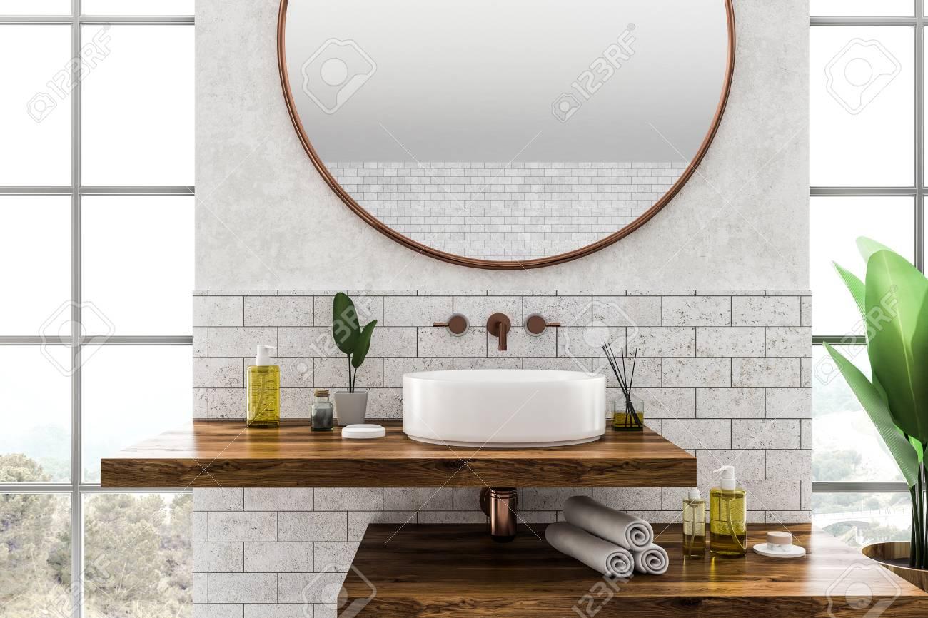 white round bathroom sink standing on wooden shelf with round
