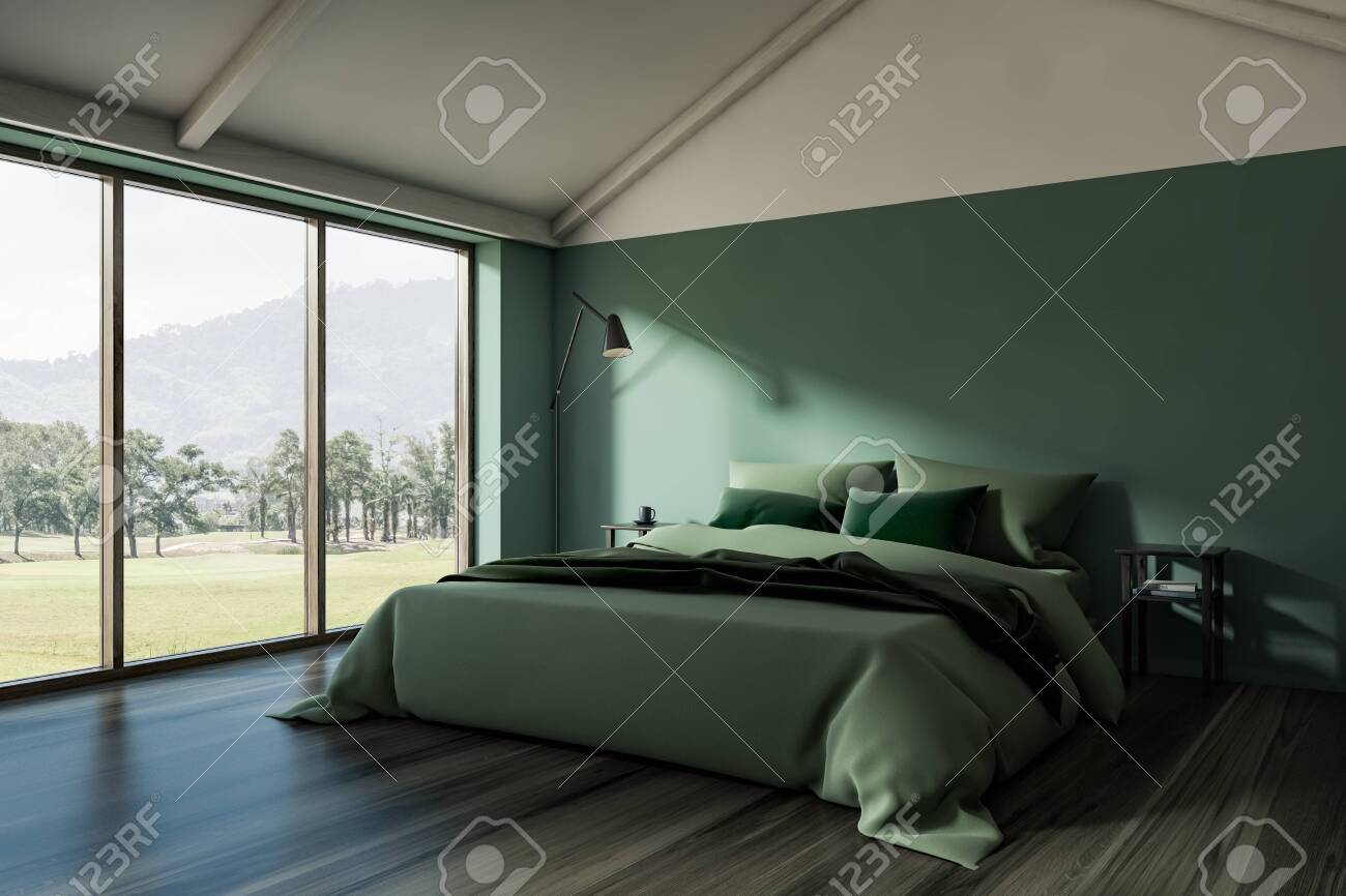 Corner Of Stylish Attic Bedroom With Green Walls Dark Wooden Stock Photo Picture And Royalty Free Image Image 128825249