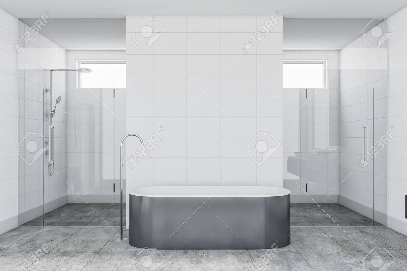 interior of luxury bathroom with white tile walls concrete floor