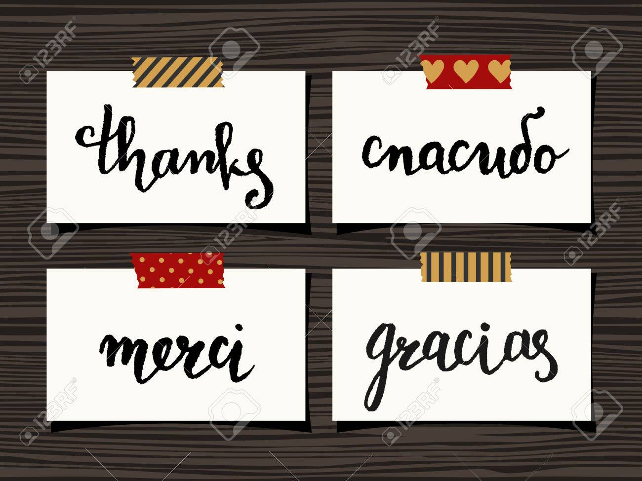 A Set Of Four Thank You Notes On Wood Background. Hand Lettered