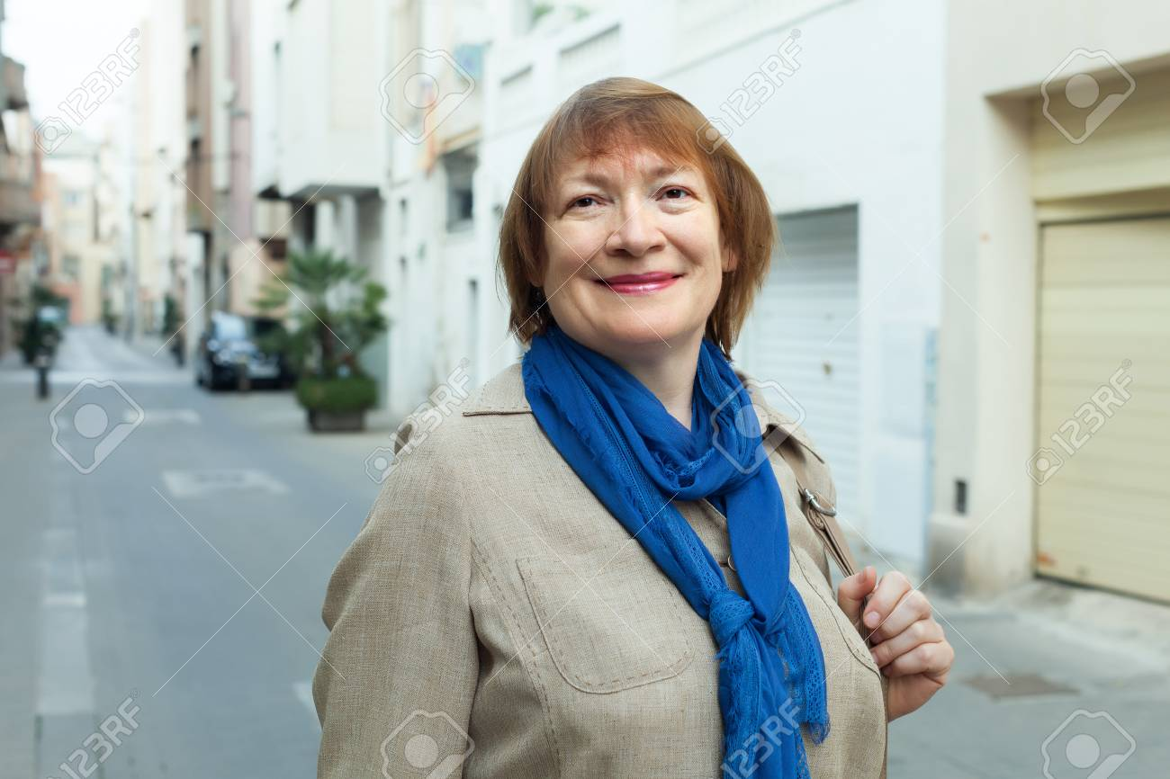 positive elderly woman wearing