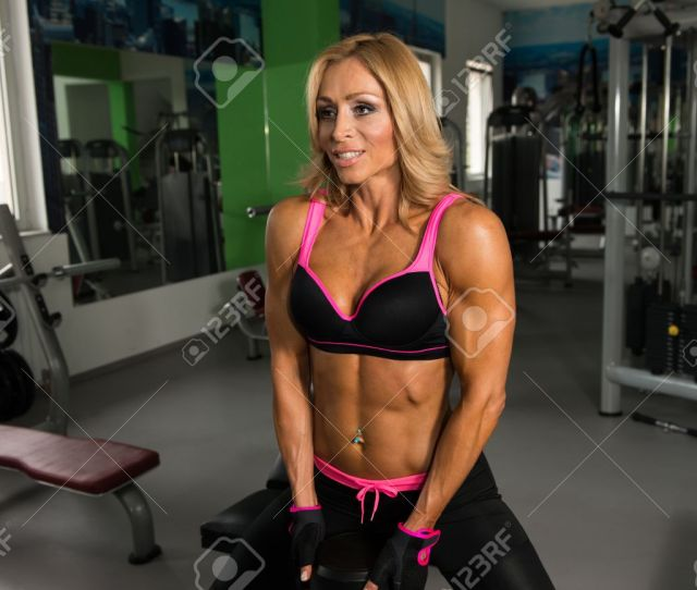 Mature Fitness Woman Working Out Ass In Fitness Center Stock Photo 68306471
