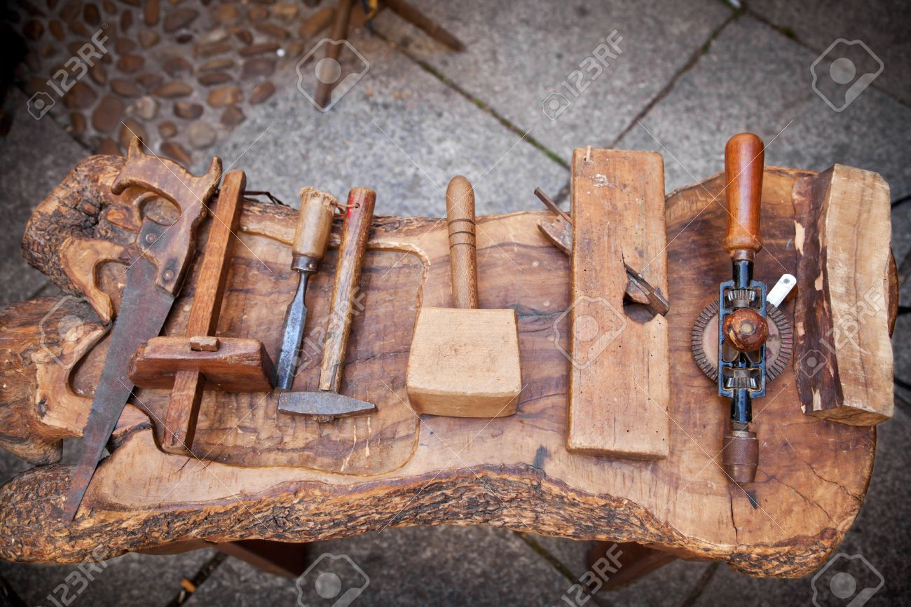 vintage carpenter tools on a rustic table