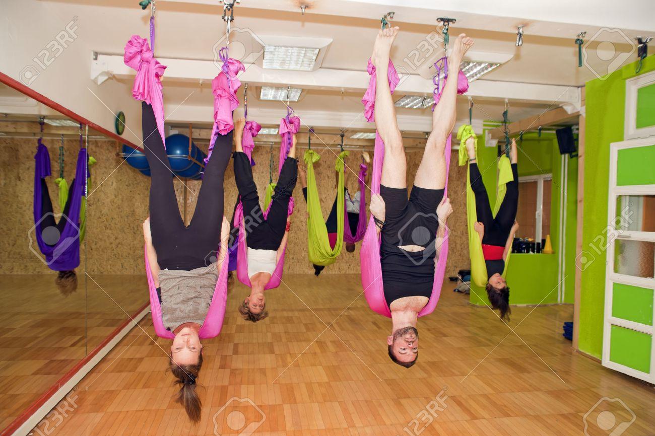 aerial yoga practicing antigravity