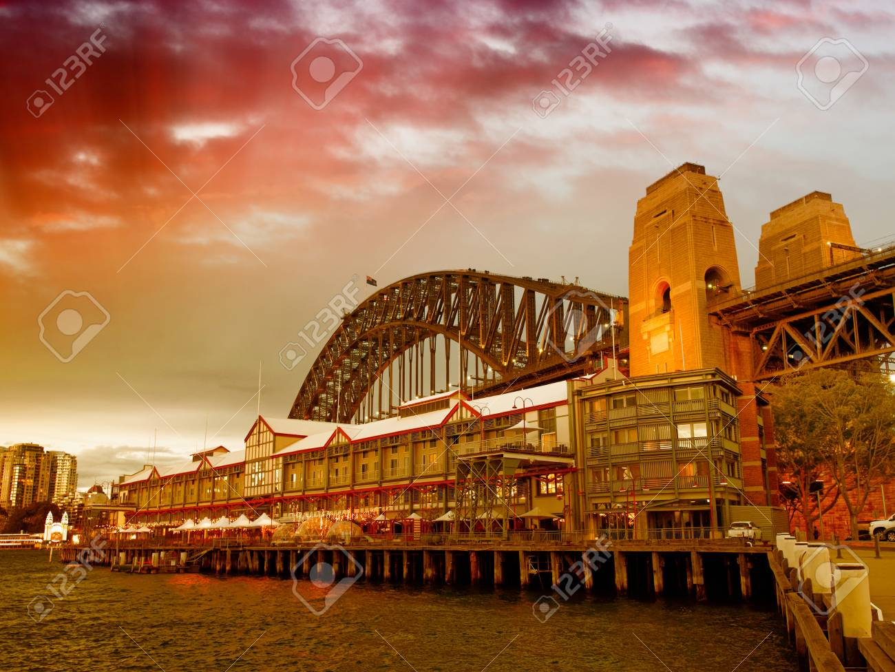 Night View Of Sydney Harbor Bridge From The Wharf At Sunset