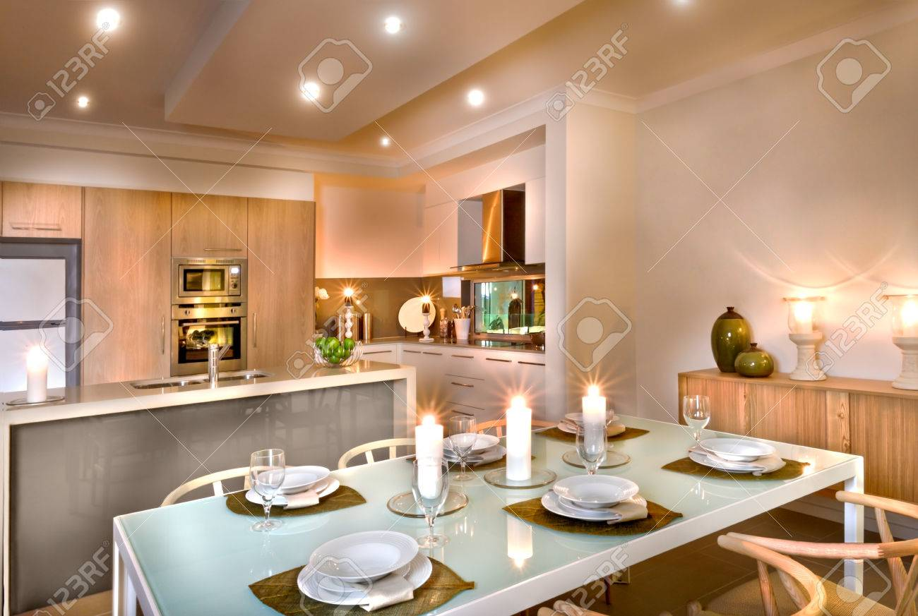 kitchen candles tall round table modern and the dining room with white everywhere wine glasses dishes on