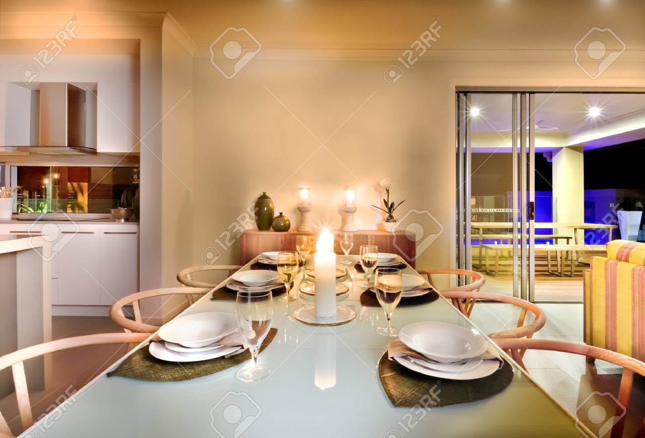 kitchen candles confidential book dinner table setting in a modern house with diner food serving near