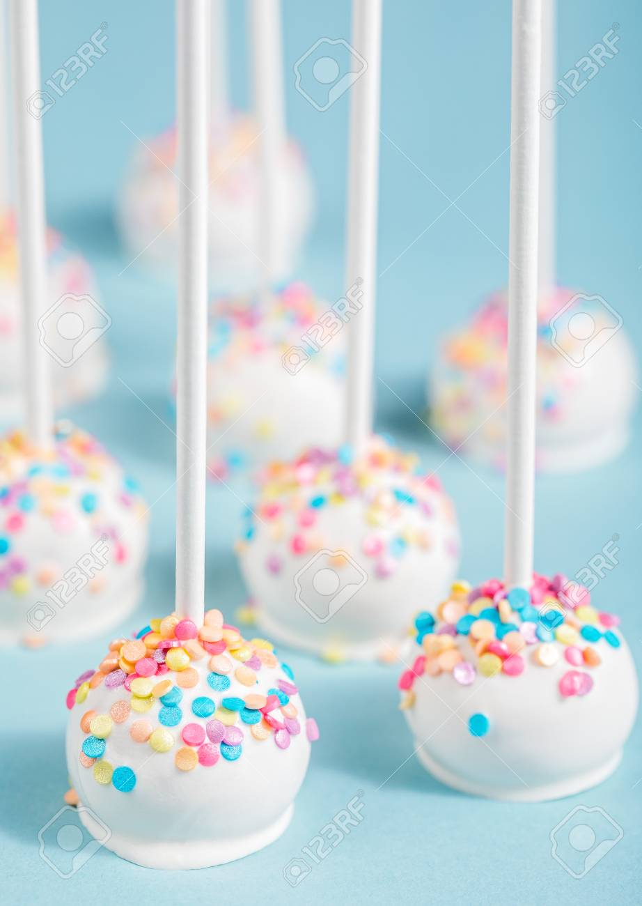 Vanilla Cake Pops With Colorful Sprinkles Over A Blue Background