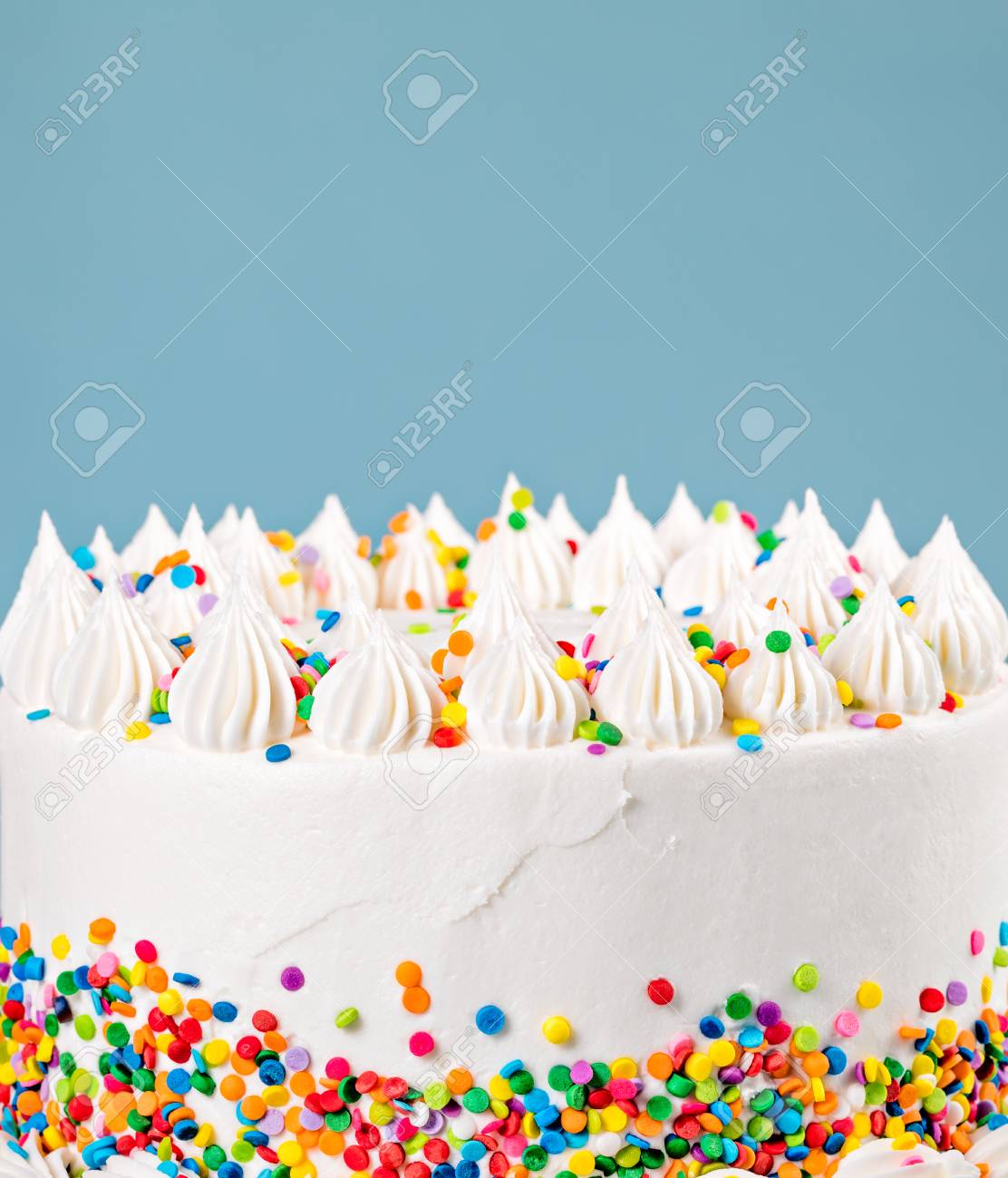 Side Of A Vanilla Buttercream Birthday Cake With Colorful Sprinkles