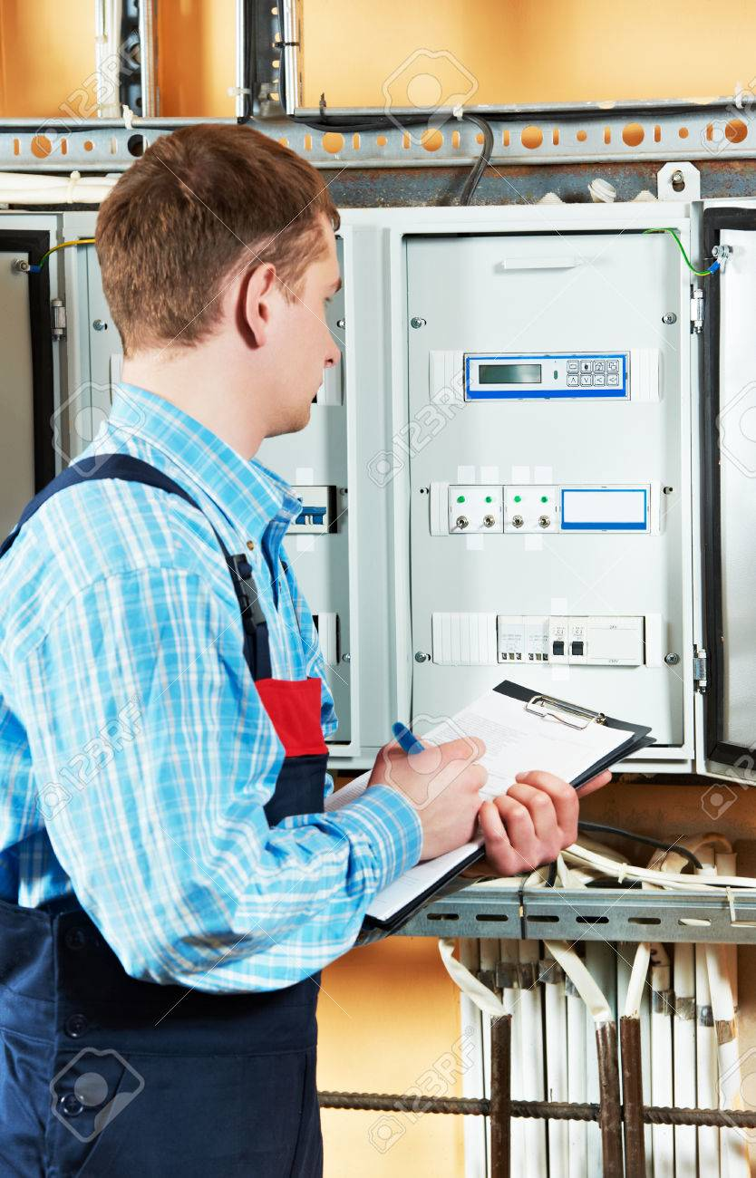 medium resolution of electrician builder engineer inspector checking data of equipment in fuse box stock photo 41478558