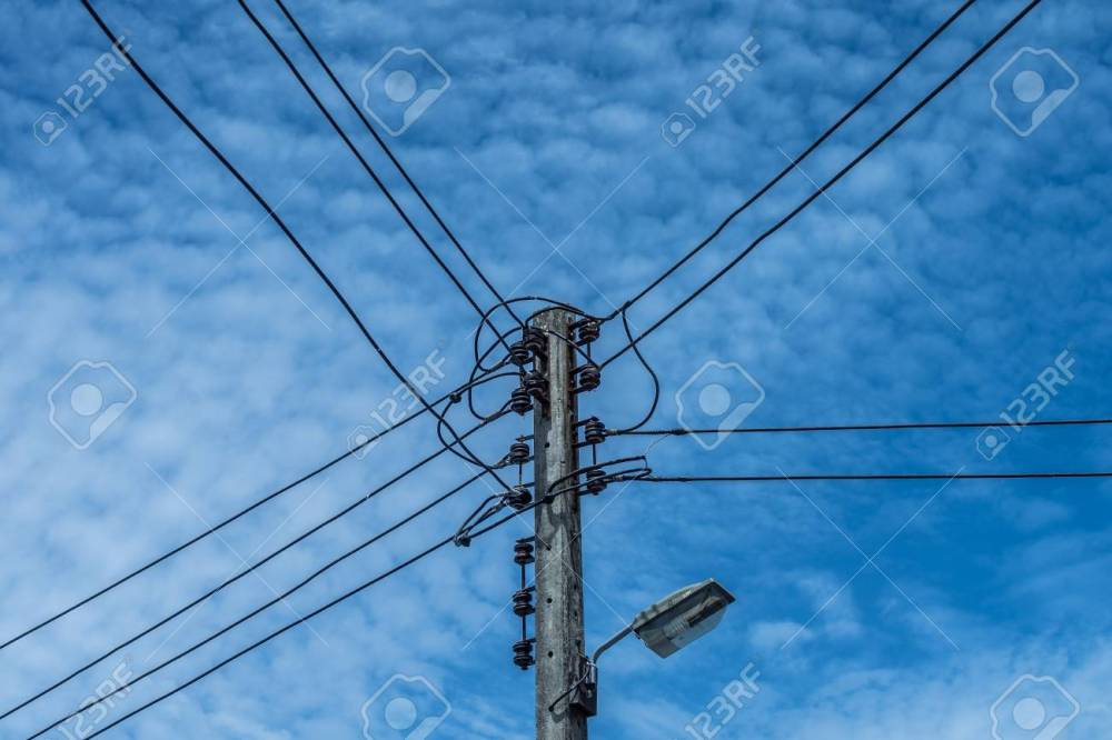 medium resolution of electric wire and lamp on electrical pole with blue cloudy sky background stock photo 107323263