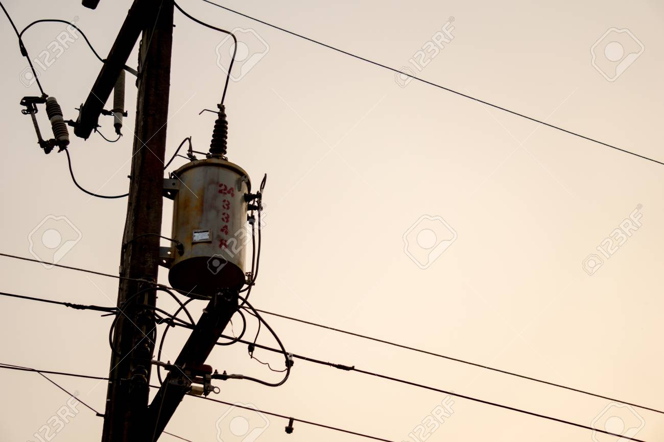 hight resolution of old and vintage electric transformer on electricity post with electricity wires and other components in rural