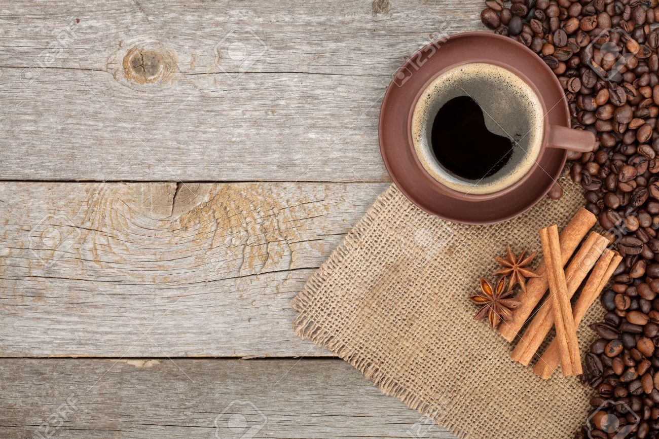 coffee cup and spices on wooden table texture with copy space