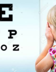 Close up rear view of girl testing eyesight infant closing one eye with hand looking also rh rf