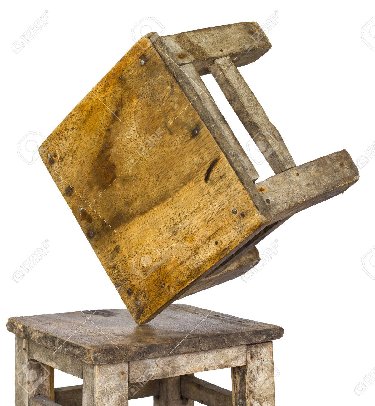 small wooden chair blue suede isolates two chairs which overturned and laid the corner were not unstable equilibrium