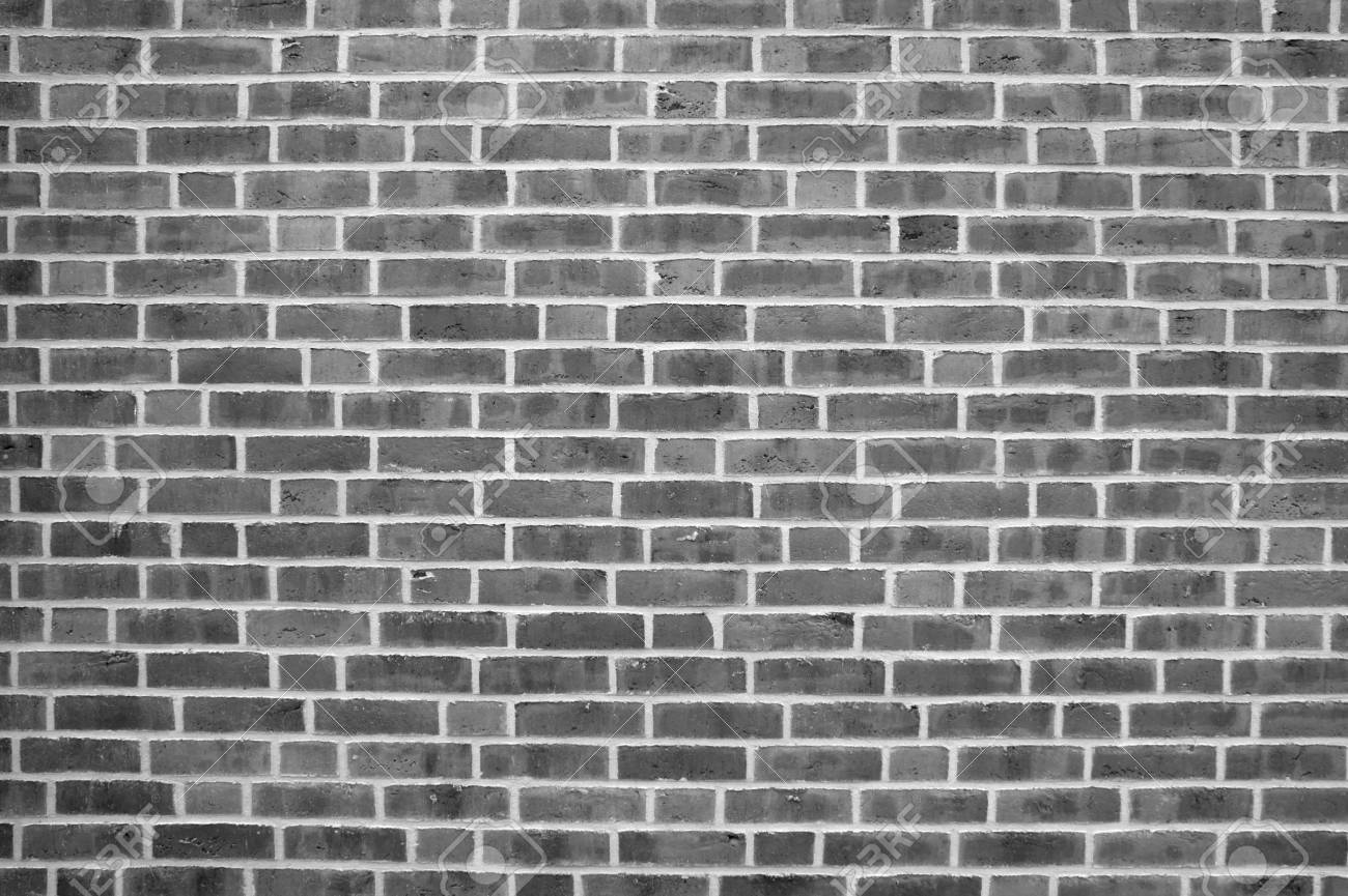 grey weathered brick wall