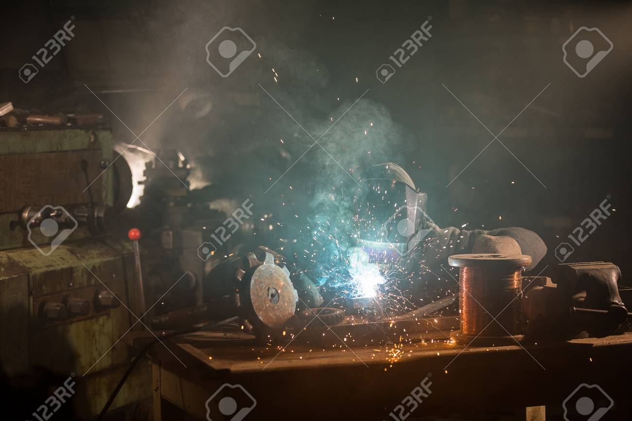 welder is welding metal