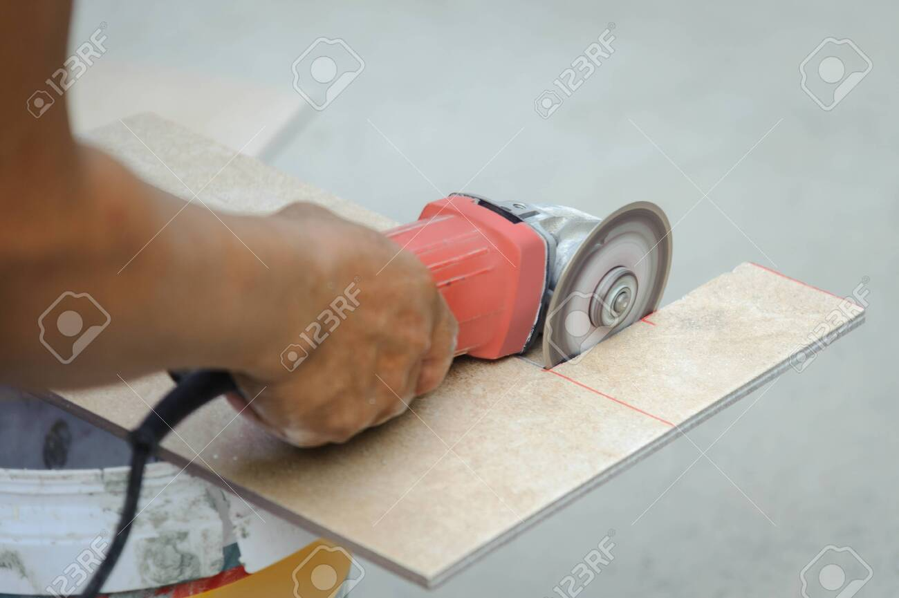 tiler used a hand grinder machine to cut ceramic tiles stock photo picture and royalty free image image 148260155