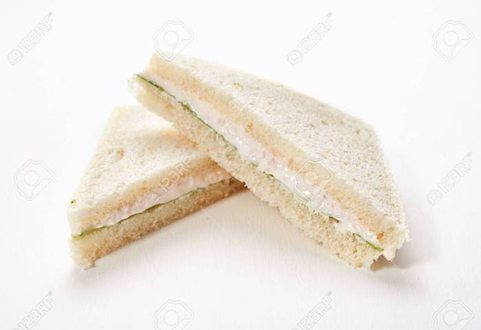 Fish White Bread Sandwiches With Salad Leaves On White Wooden