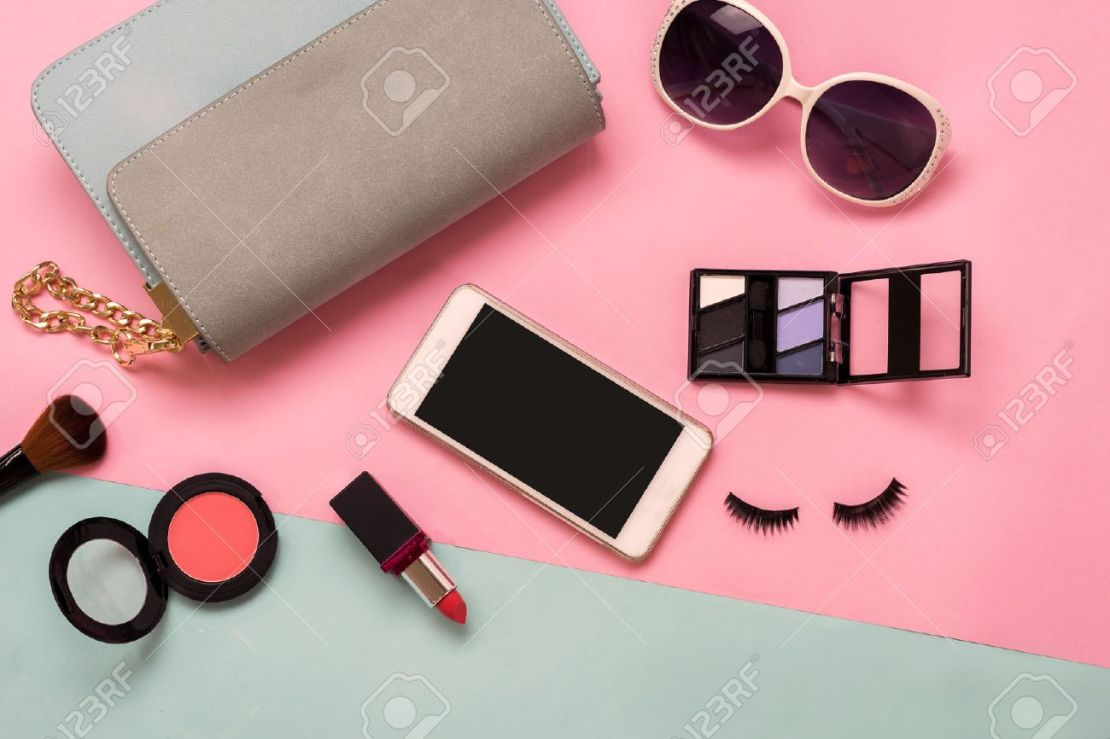 Fashion Woman Essentials, Cosmetics, Cellphone, Makeup Accessories.. Stock  Photo, Picture And Royalty Free Image. Image 63831407.