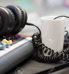 headphones with spiral cord in radio studio stock photo 79451264 [ 1300 x 866 Pixel ]