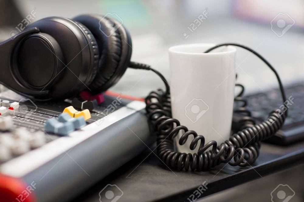 medium resolution of headphones with spiral cord in radio studio stock photo 79451264