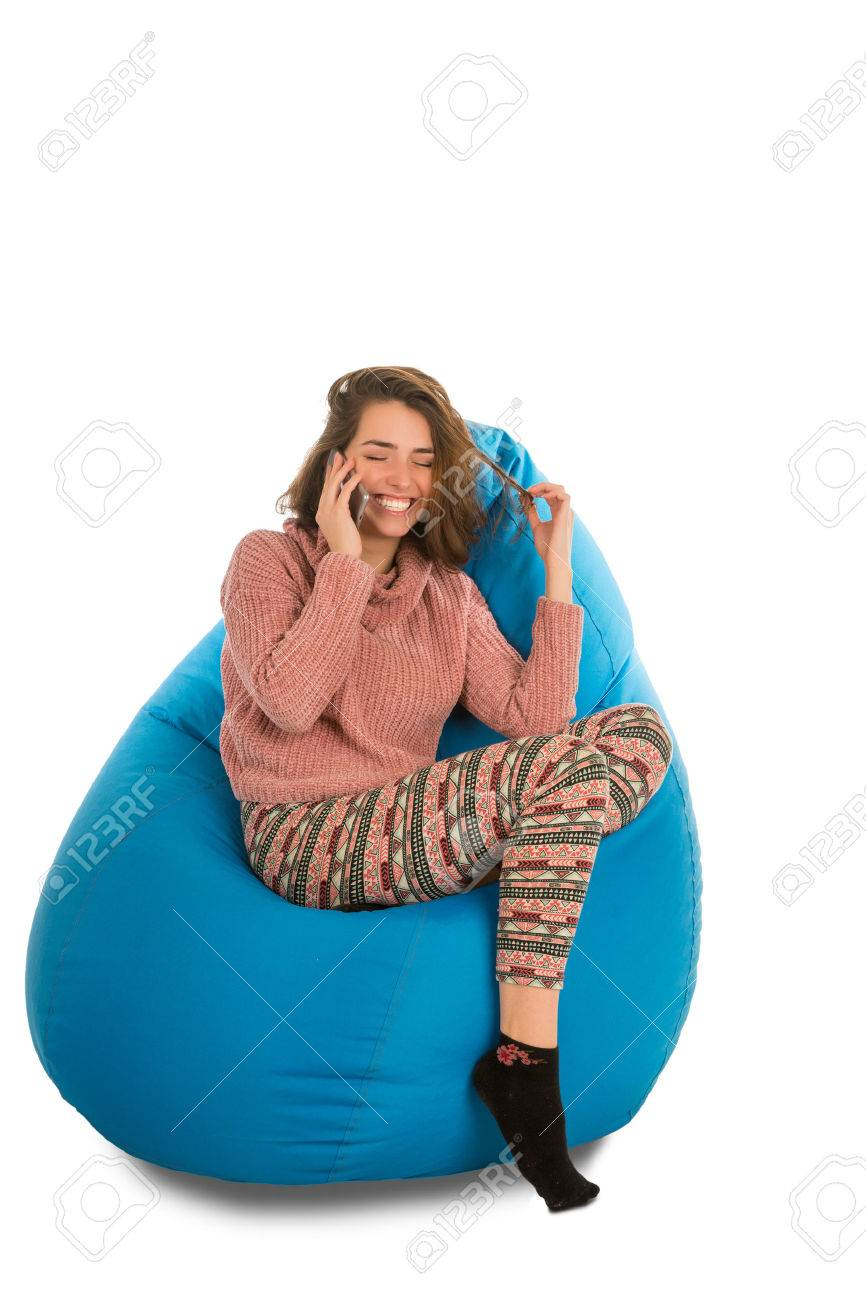 blue bean bag chairs hanging chair range laughing young woman sitting on beanbag for living room or other and talking