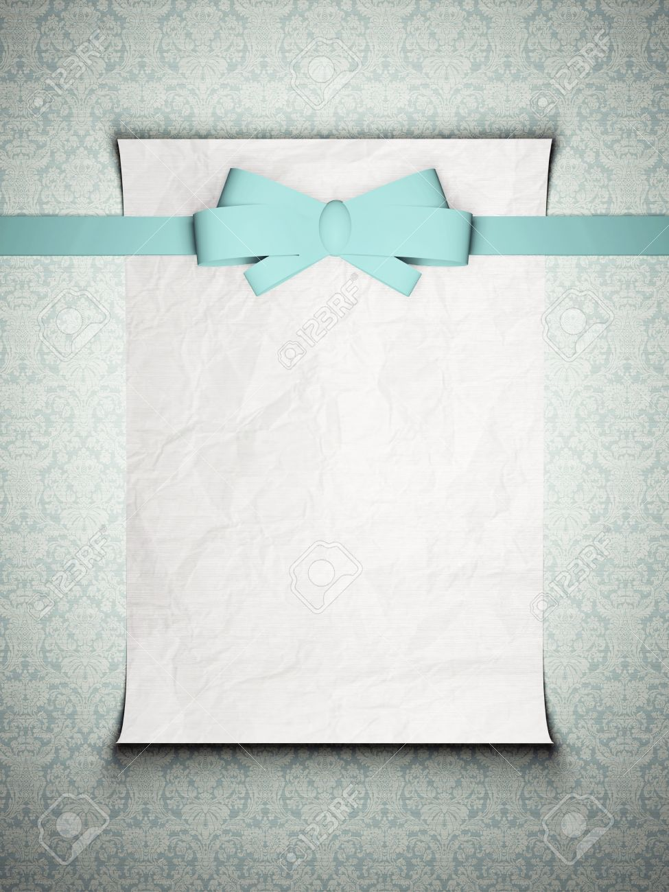 wedding invitation card with blue ribbon in front on the vintage