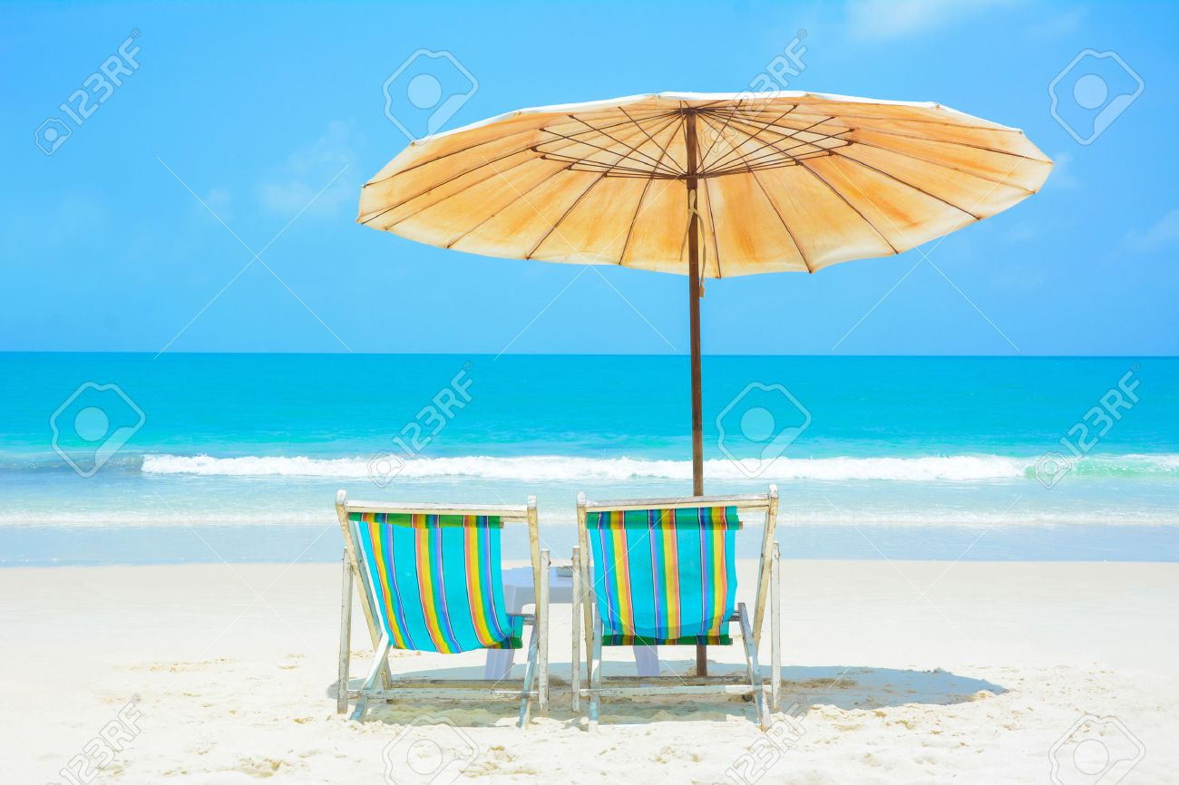 Beach Chairs With Umbrella Blue Sea And White Sand Beach With Beach Chairs And Umbrella