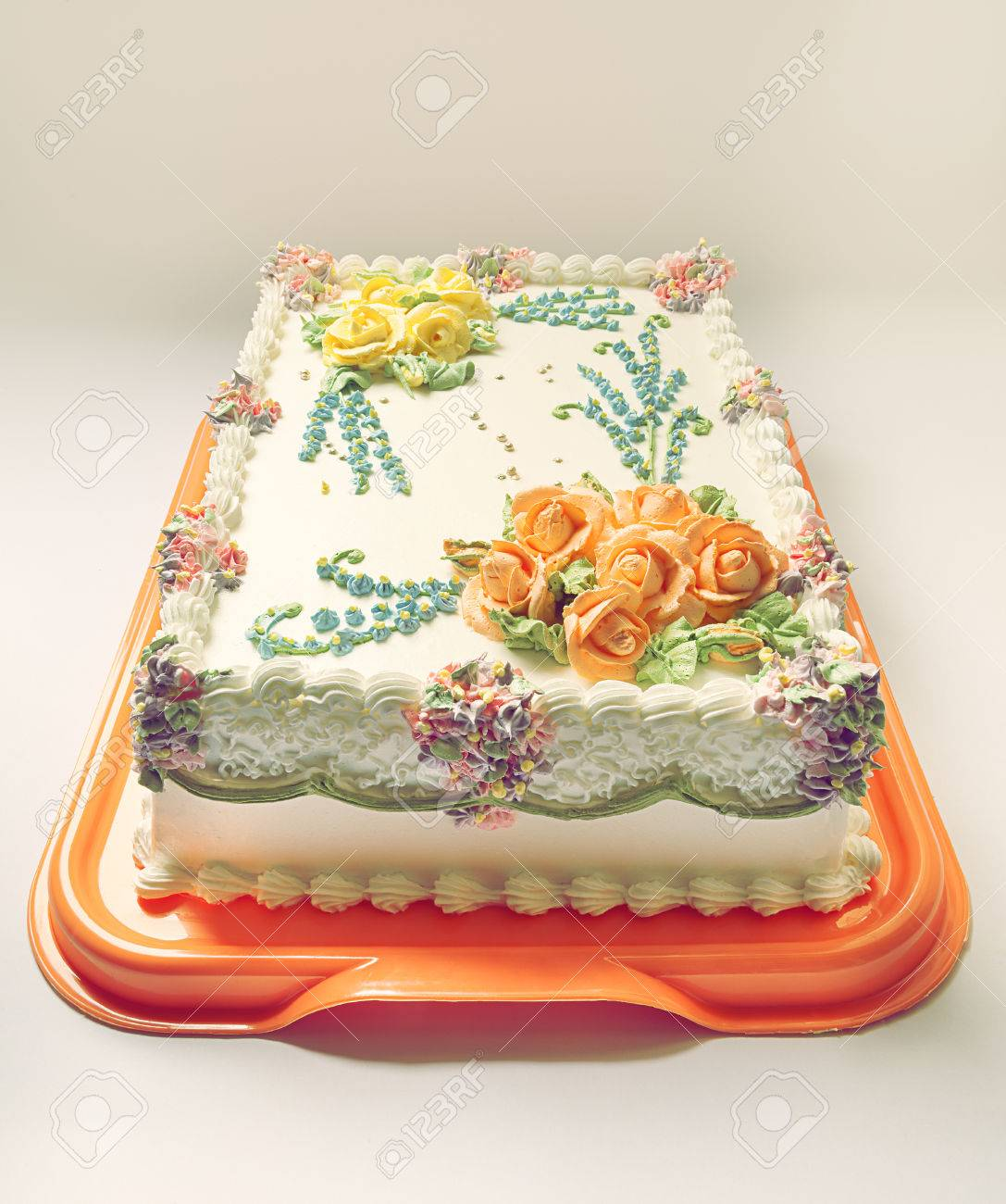 Classical Birthday Cake Design With A Lot Of Flowers Of Cream Stock