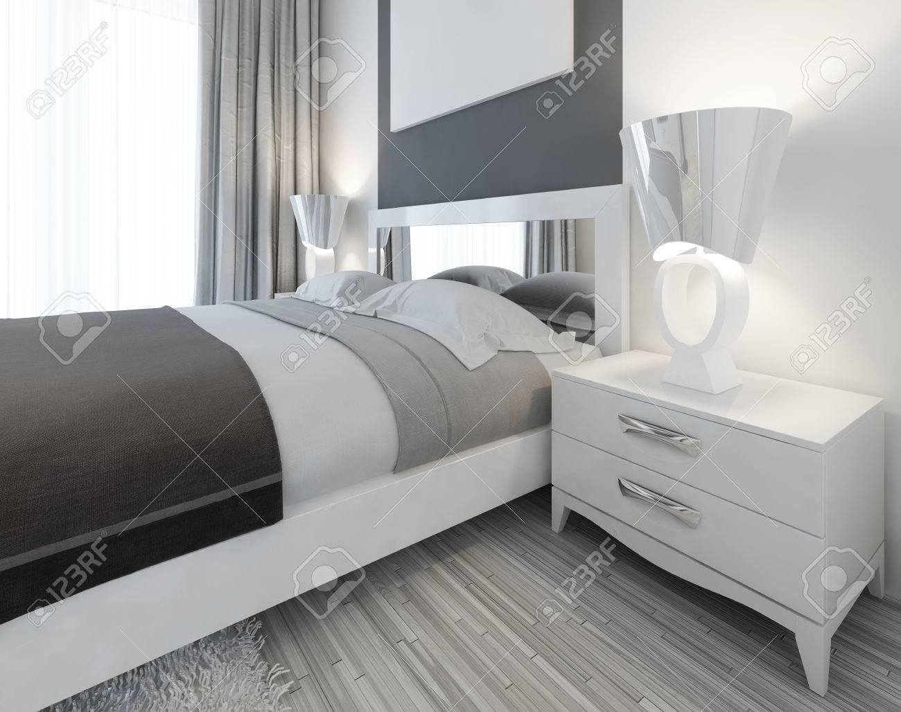 modern white nightstand with a lamp by the bed in a bedroom contemporary