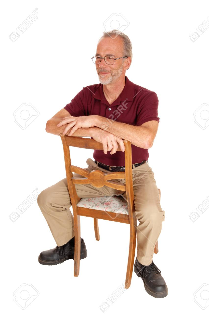 Chair Pants A Serious Older Man In Beige Pants And Burgundy T Shirt Sitting