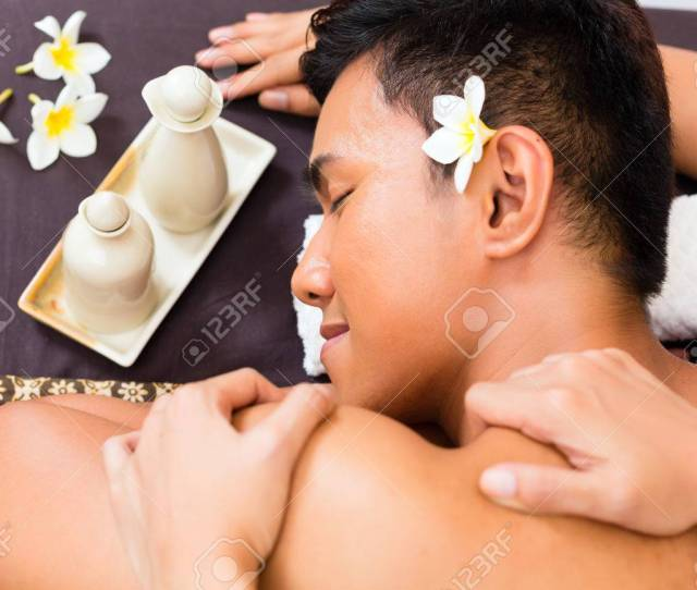 Indonesian Asian Man In Wellness Beauty Spa Having Aroma Therapy Massage With Essential Oil Looking