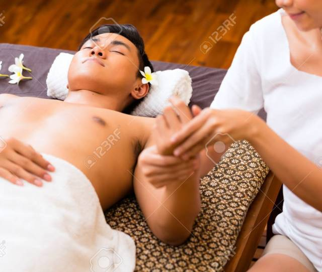 Indonesian Asian Man In Wellness Beauty Spa Having Aroma Therapy Hand Massage With Essential Oil