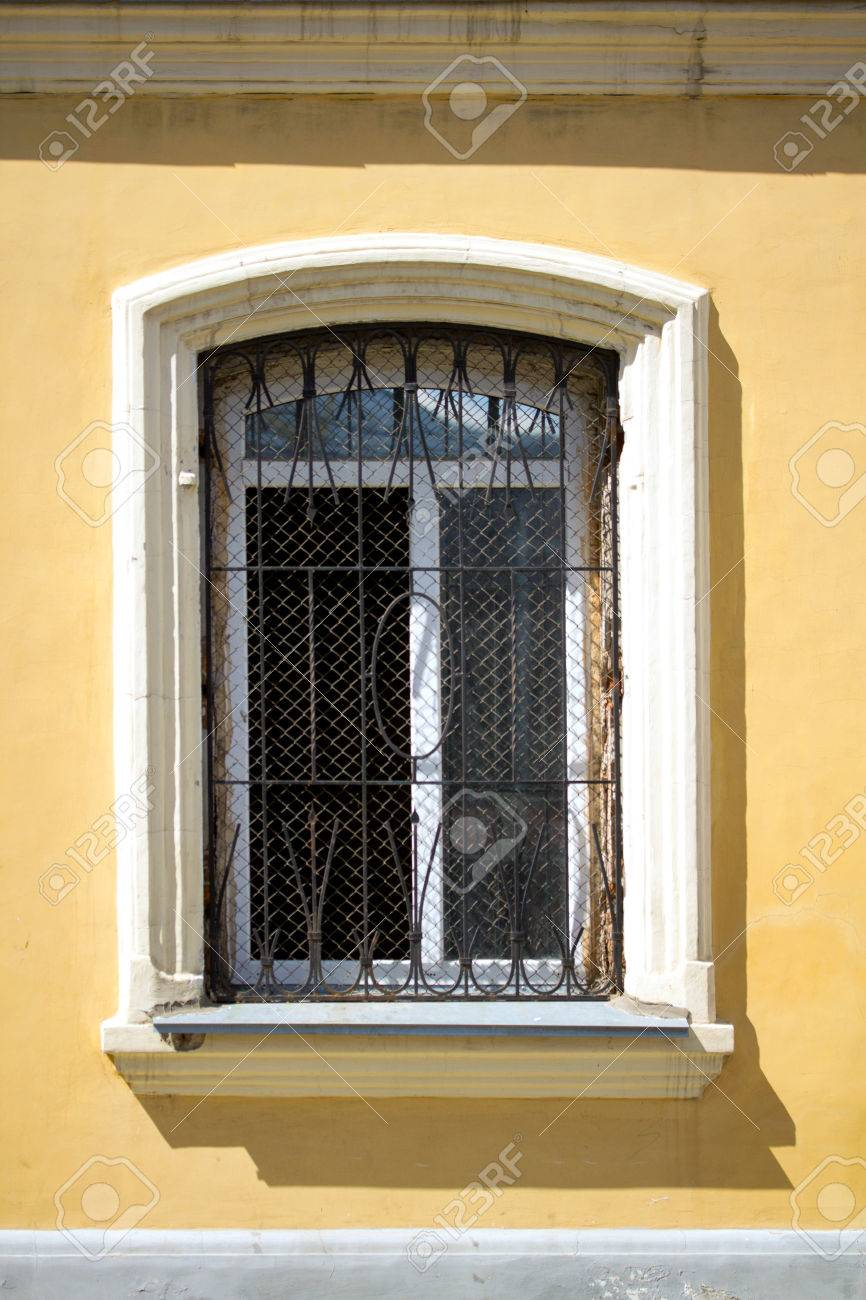 Antique Window Shutters On Yellow Wall Background