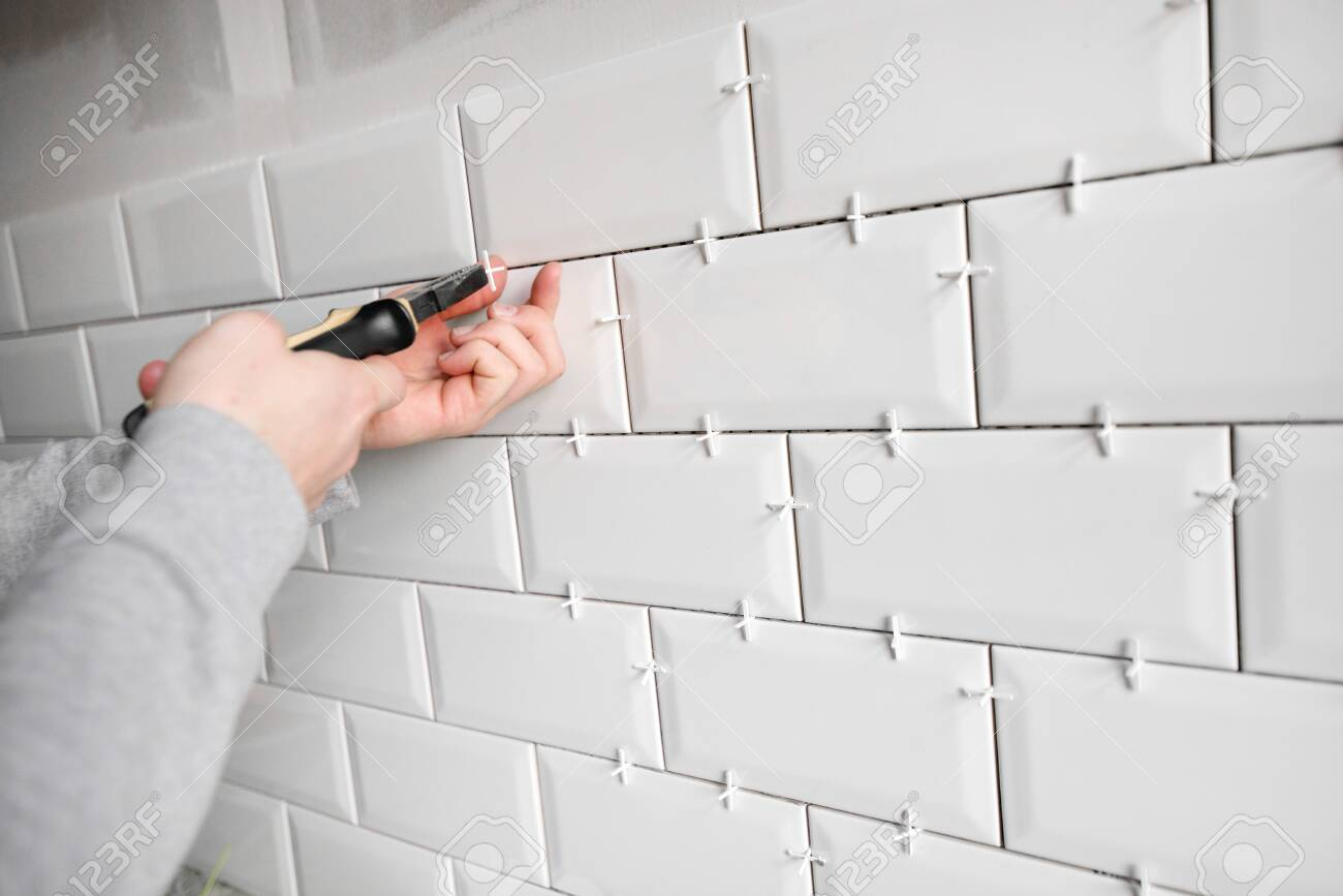 ceramic tile lying installing new subway or metro tiles in bathroom stock photo picture and royalty free image image 118859355