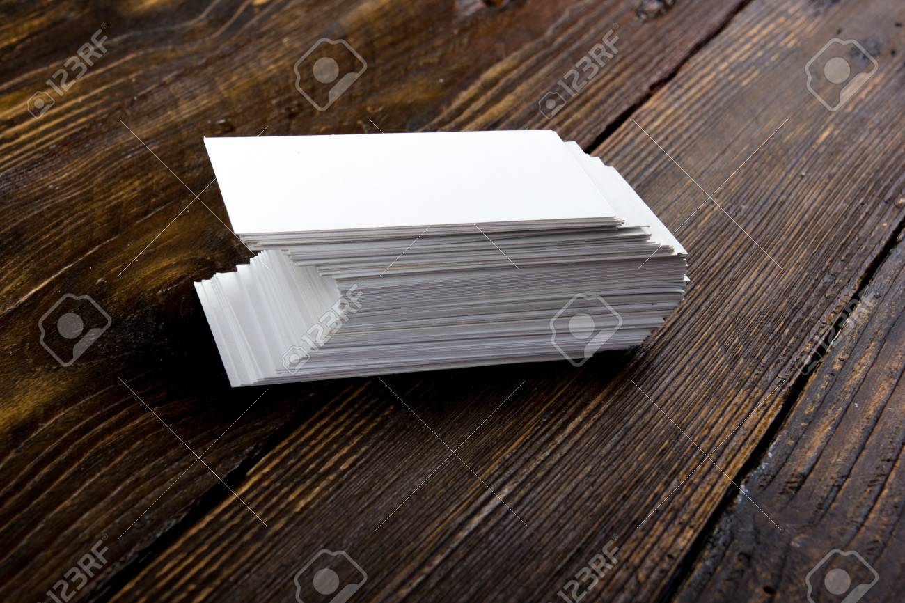 Blank Business Cards On The Wooden Table. Template For Id. Top View. Stock