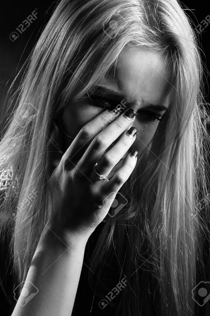 sad girl crying covering