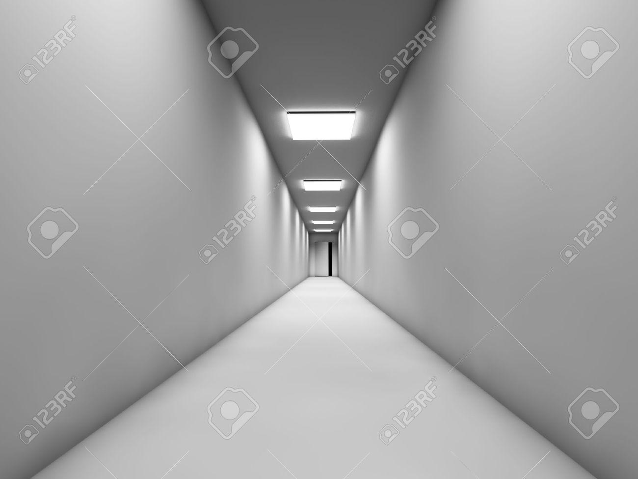 long couloir blanc avec la porte a la fin