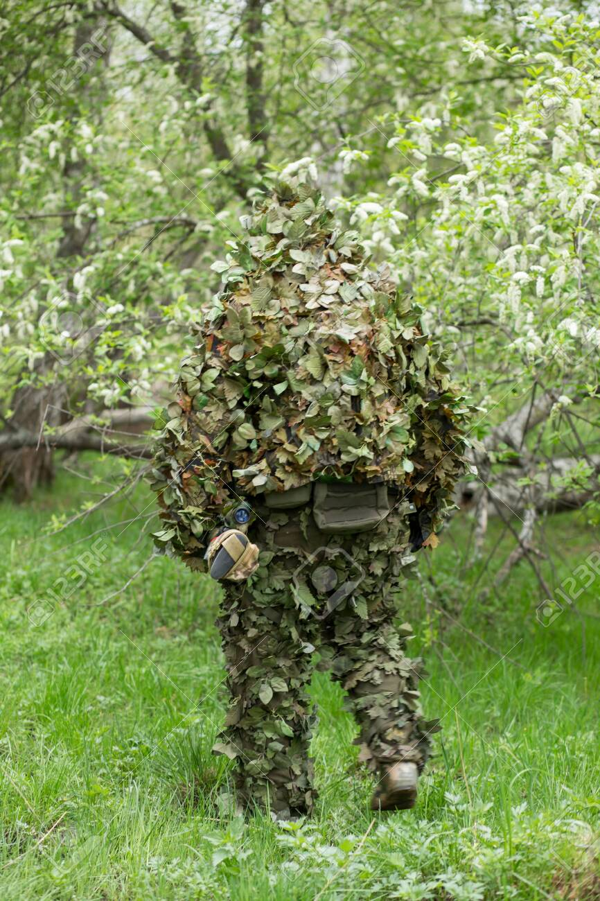 sniper in green camouflage