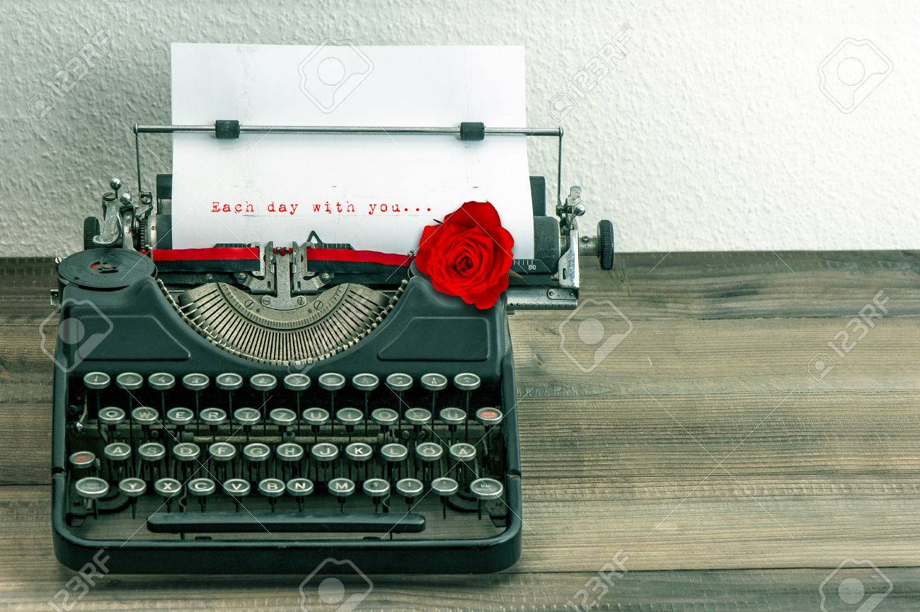 Stock Photo - Vintage Typewriter With Love Letter And Red Rose Flower Sample  Text Each Day With You