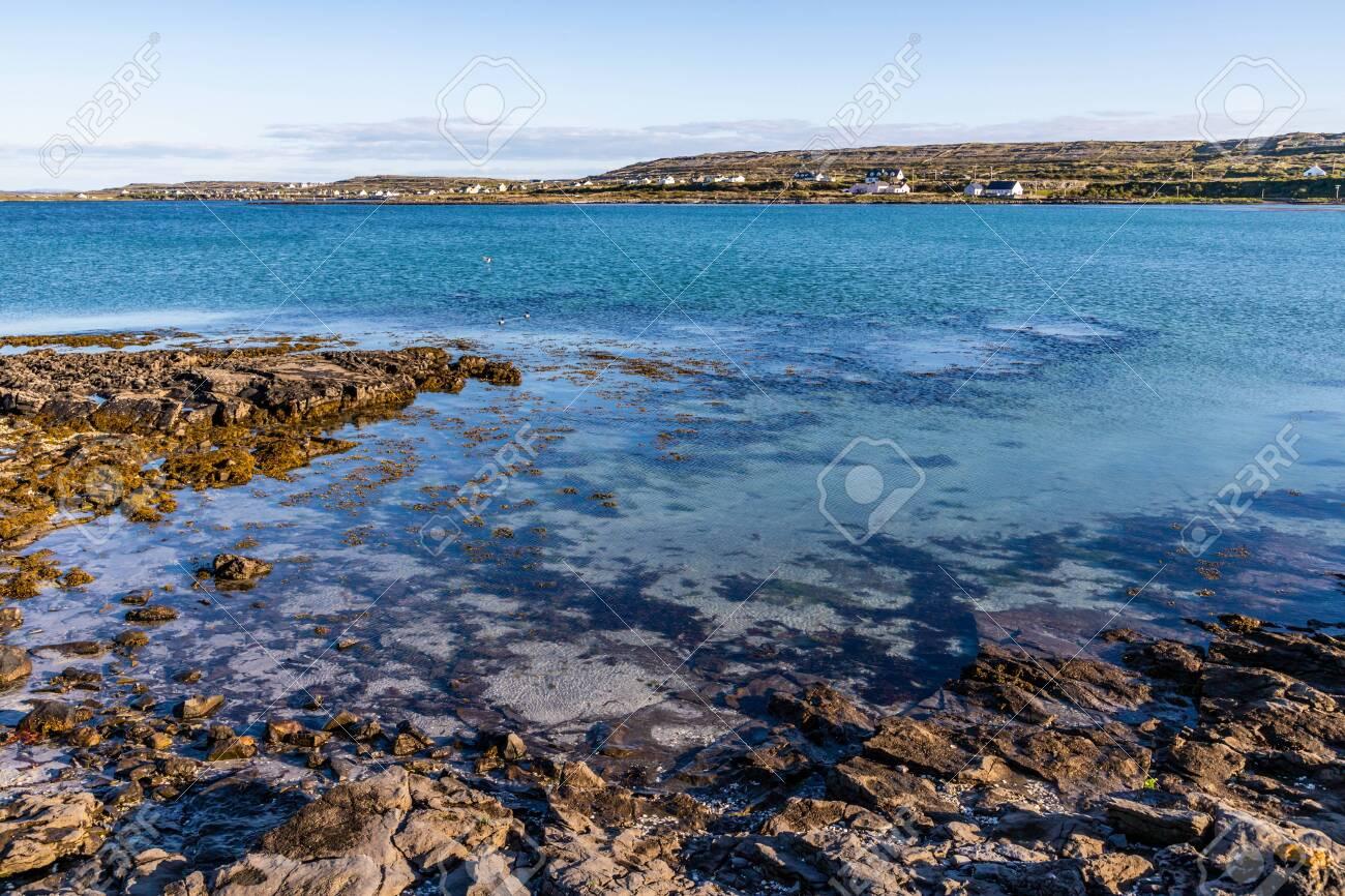 Beach In Kilronan With Houses In Background In Inishmore Aran