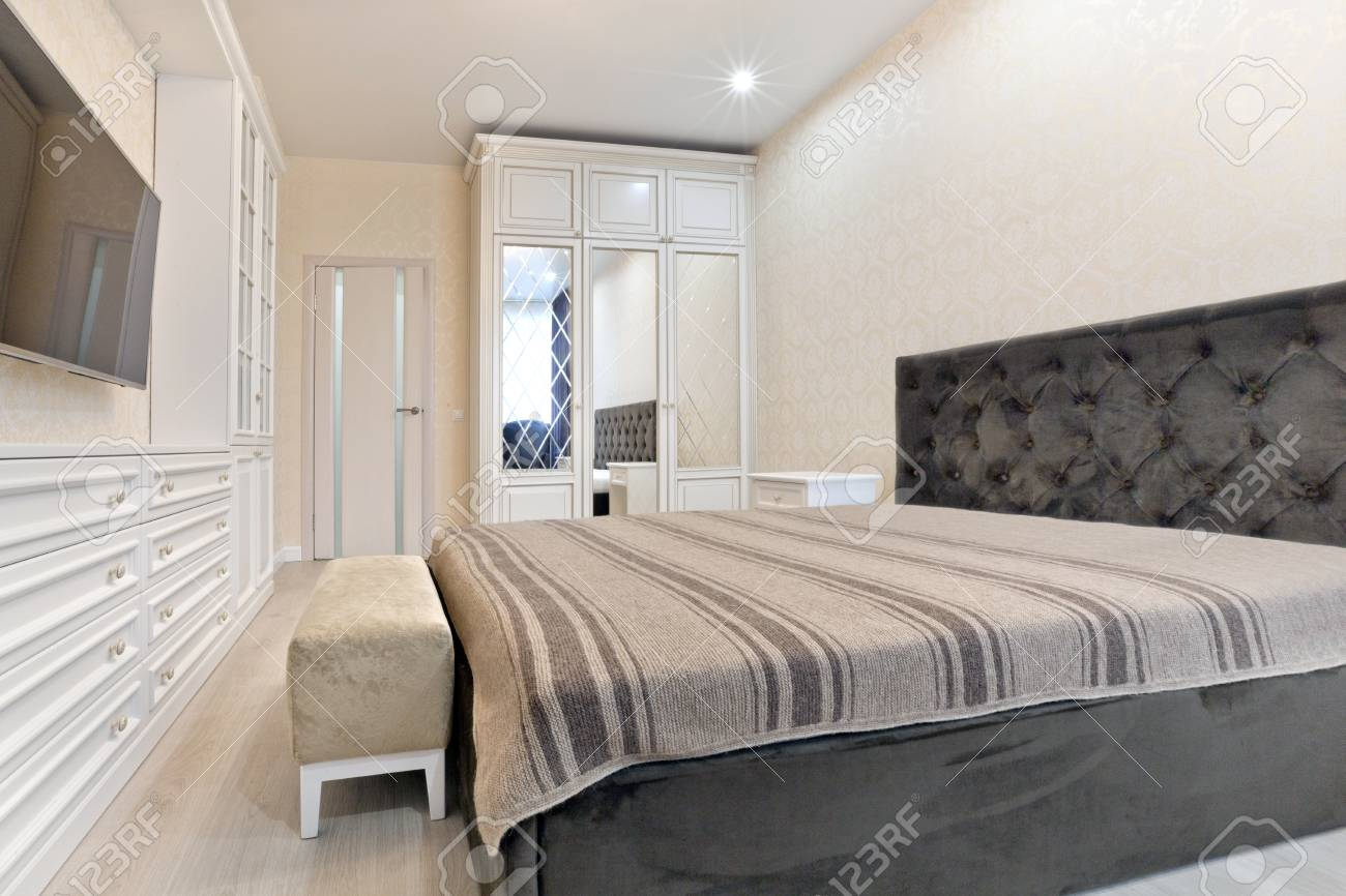 Bedroom In Light Colors With Wooden Furniture Stock Photo Picture And Royalty Free Image Image 94178600