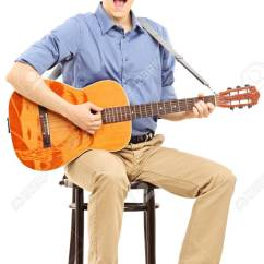 Guitar Playing Chair Drafting Chairs With Arms Young Man Sitting On A And Acoustic Isolated Stock Photo White Background